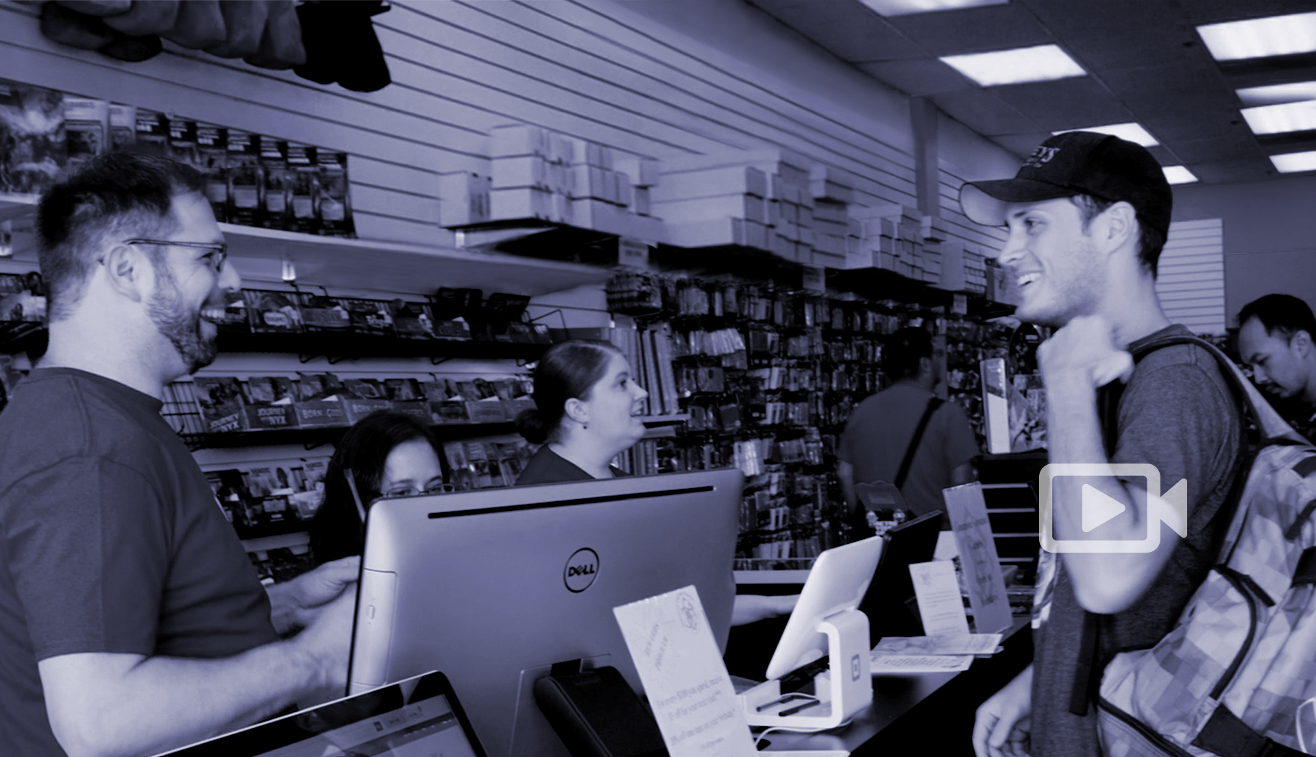 Header image, men smiling across a store counter