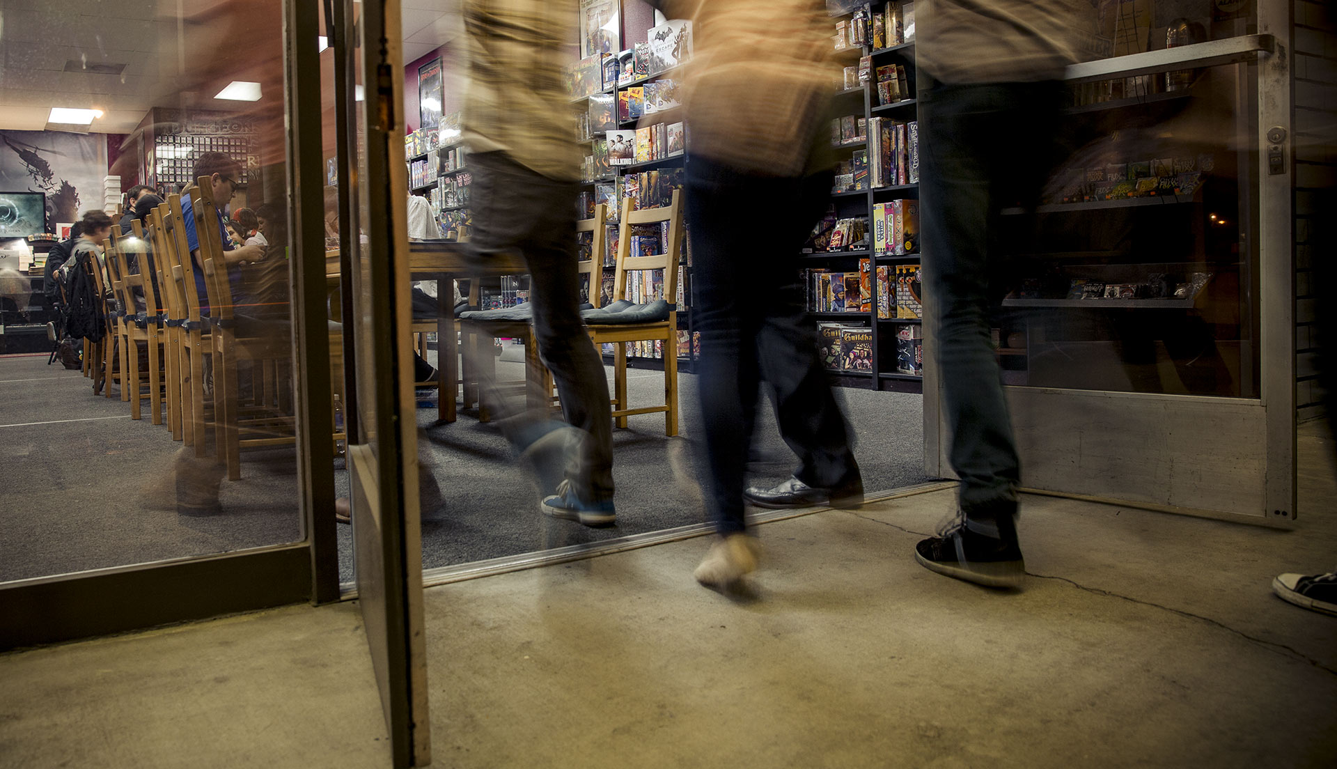 Header image, people entering a game store